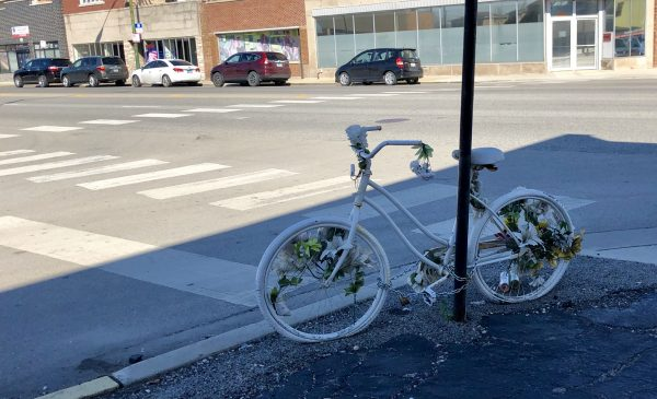ghost bike dedicated to Lisa Shalk, who was killed by a driver while riding her bike at the intersection of Archer Avenue and Lorel Avenue in November 2017