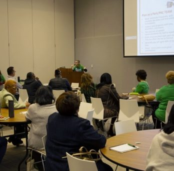Louise McCurry gives a presentation to the audience at the 2019 Park Advisory Council Conference