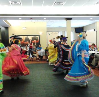 Pilsen Senior Center residents engage in traditional folk dancing.