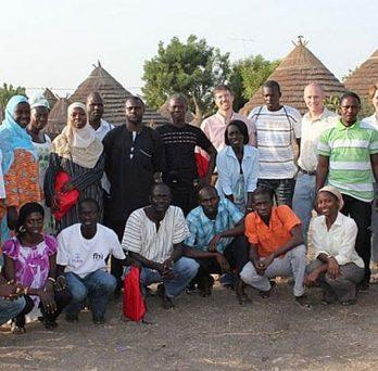 Illinois PRC investigators pose with research team members in Senegal.
